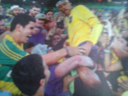 Neymar, Captain of Brazil football team lifted by crowd after winning the Gold Medal for Brazil.
