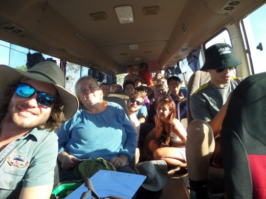 The 20 of us in the van with our tour guide Tom in front