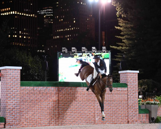 Andrew Kocher riding Chavinia over the wall.