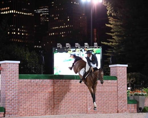 Andrew Kocher riding Chavinia over the wall.