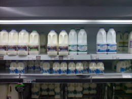 Normal milk and Omega-3 laden Clever milk side by side in the supermarket