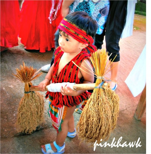 "The very cute ""grain"" bearer in his traditional suit  as part of the wedding entourage."