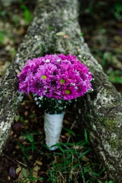 Wedding bouquet with purple flowers.