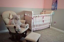 Bedroom for baby with colour scheme pink and grey