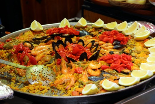 Seafood paella is a popular Spanish dish that uses a touch of saffron to tint and flavor it.