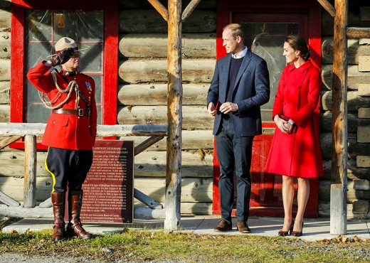 a Mountie salutes the Duke and Duchess as they exit the MacBride Museum of History