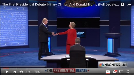 HRC steps into the handshake, further moving her left shoulder away and creating distance between the two candidates. DJT remains squarely faced forward toward HRC.