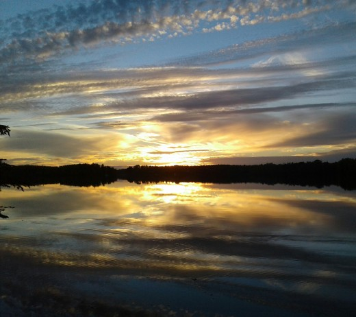 Nature offers inspiration. Here a sunset overy a lake reminds us of all the beauty surrounding us.