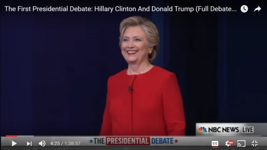 The camera zooms in on HRC, we do not see DJT in this frame.  HRC has her head positioned upward; she gazes to the opposite side of the stage.