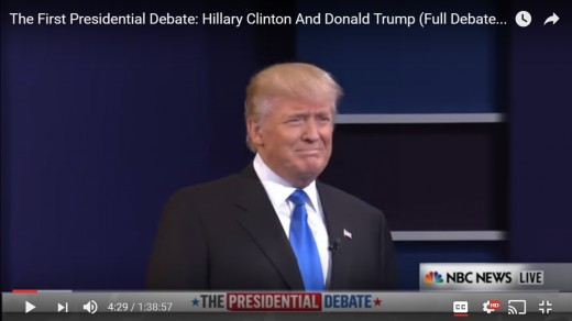 DJT turns his head toward the approaching HRC.  His head remains erect.