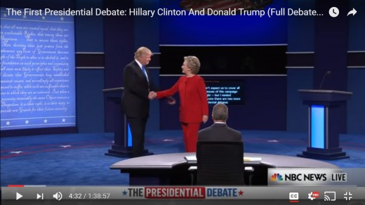 DJT reaches left arm behind HRC's back. Distance between the two begins to narrow. DJT's body remains square; HRC's body remains sideways.