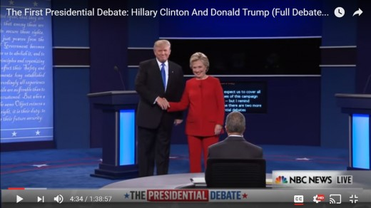 DJT opens hand from shake first. Both candidates remain for a moment in photo op position, facing the audience squarely.