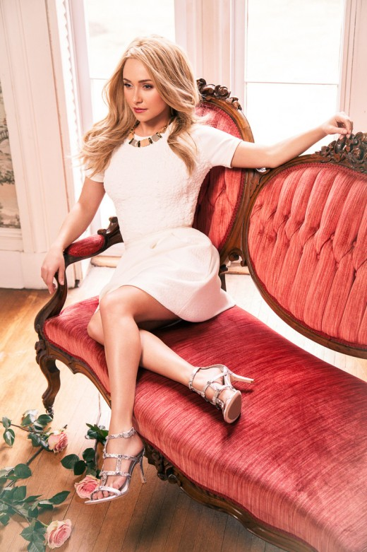 Hayden Panettiere lounging on a sofa or Belk ad