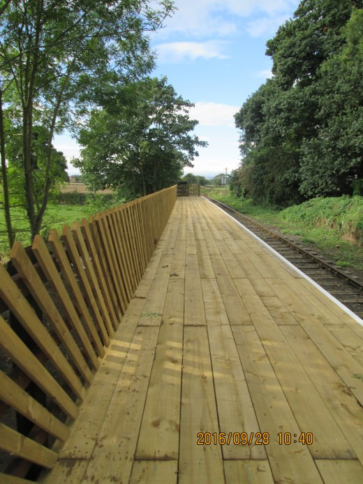 The rails at the back of the platform are in the old North Eastern Railway diagonal style (as on the NYMR stations)