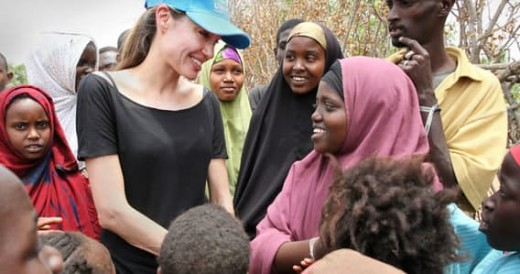 Angelina Jolie helping the poor and needy.