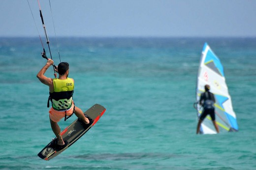 Acrobatic windsurfers add to the attraction of Palm Beach in Aruba.