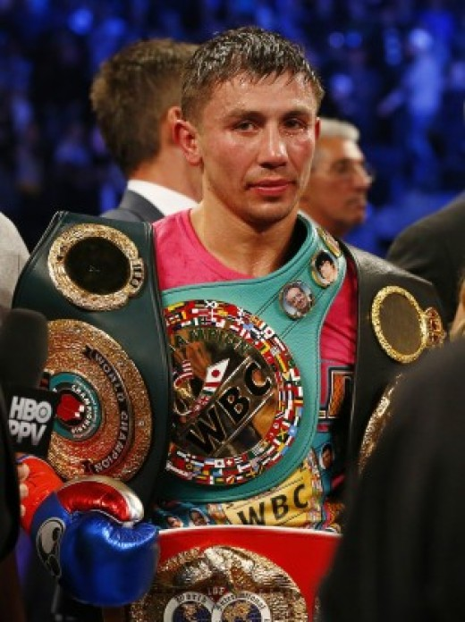 GGG proudly wearing his world title belts