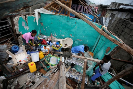 Residents work to clear a house of debris after Hurricane Matthew struck Les Cayes, Haiti. Photo by Andres Martinez Casares/Reuters