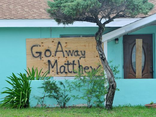 Sign posted in Brevard County, Florida the hope that Hurricane Matthew would change its course.