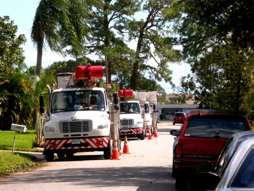 Power trucks and tree-trimming experts line the streets of my neighborhood as they worked to restore power.