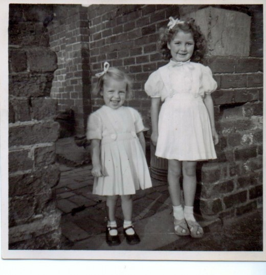 The two eldest of the four girls at the entrance to the back yard of Nanny's house circa 1951