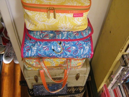 Lilly Pulitzer for Target toiletry bags and vintage suitcases.