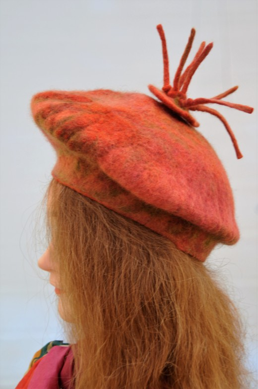Wet felted beret with decorative pin