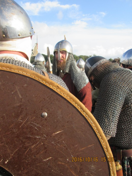 A sea of steel catches the light in mid-afternoon, helms, mailcoats, swords and axe-heads