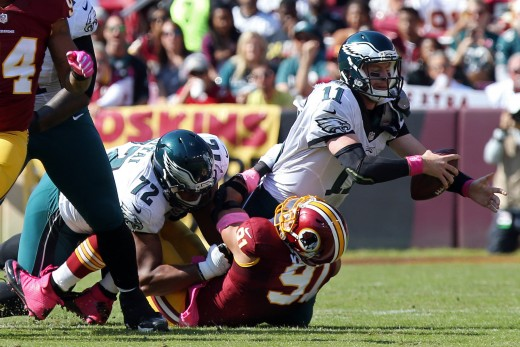 Eagles Rookie RT Halapoulivaati Vaitai couldn't keep Redskins OLB Ryan Kerrigan off QB Carson Wentz