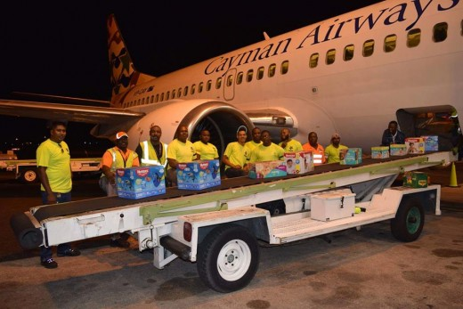 Cayman Airways being loaded with supplies that will be taken to Haiti.