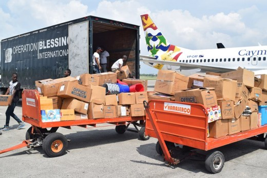 Operation Blessings truck arrives at the airport in Port-Au-Prince Haiti to collect aid from the Cayman Islands that was just delivered on Cayman Airways.