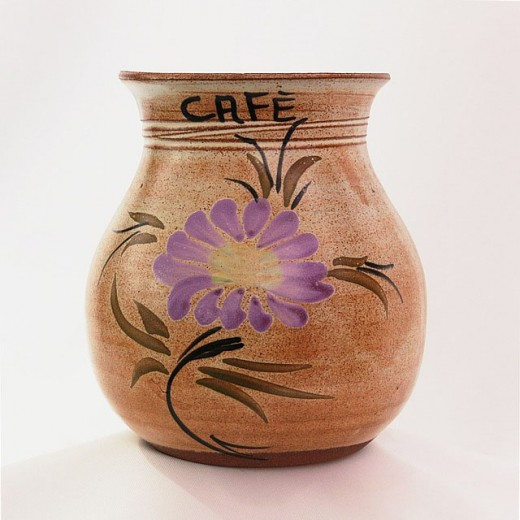 A ceramic vase constructed by a craftsman and a floral design painted by an artist.