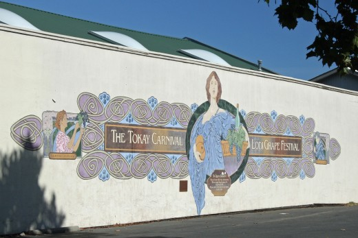 """""""The Tokay Carnival/Lodi Grape Festival"""" is one of 11 murals painted by the WallDogs around Downtown Lodi to celebrate Lodi's centennial in 2006."""