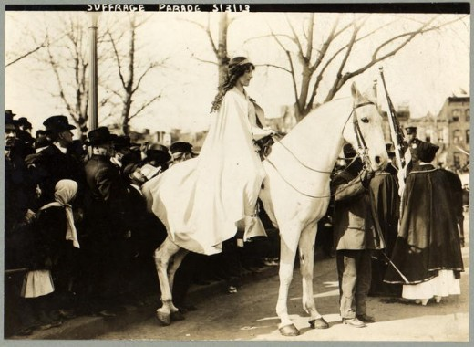 Inez Milholland Boissevain, wearing white cape, seated on a white horse at the National American Woman Suffrage Association parade, March 3, 1913, Washington, D.C.