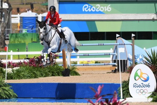 Meredith Michaels-Beerbaum riding Fibonacci over the water jump at the 2016 Rio Olympic Games.