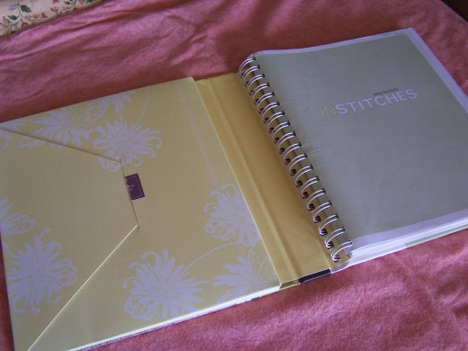 Envelope holds pattern pieces, while spiral binding allows pages to lay flat.