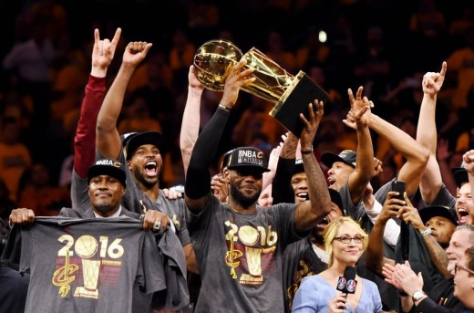 The Cavaliers celebrate their NBA title as LeBron James hoists the 2016 NBA Championship trophy after the Cavaliers defeated the Golden State Warriors 93-89 in Game 7 of the 2016 NBA Finals.
