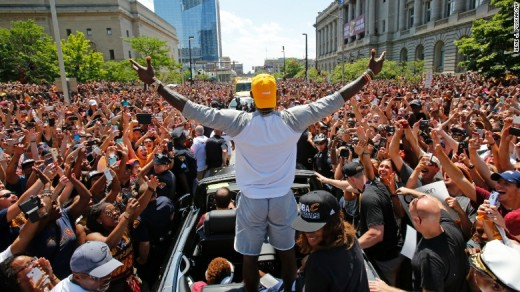 LeBron James acknowledges the sea of Cavalier fans during the Cavs' championship parade in Downtown Cleveland.