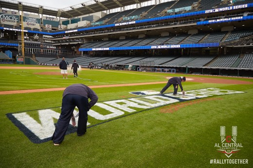 The grounds crew at Progressive Field paints the 2016 World Series logo onto the field.