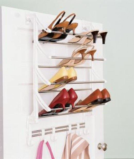 Shoe rack on the back of a door.