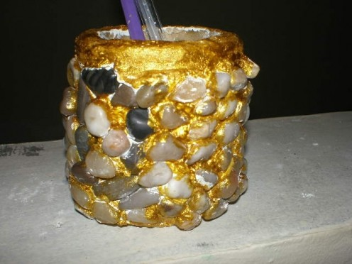 A Pencil holder decorated with ornamental stones.