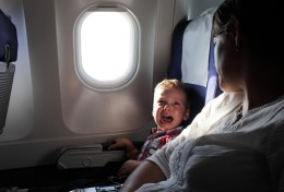boy crying on the airplane