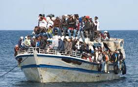 This is a boat full of illegal emigrant people, they could be said to be lucky, because even if the boat is overloaded, it is still floating and they seem safe enough.