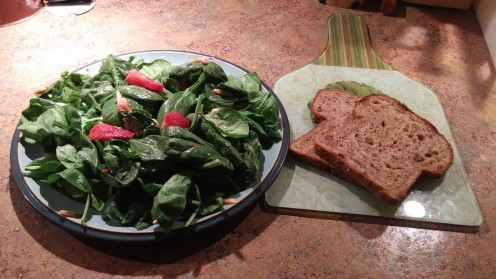 A delicious spinach salad with fresh strawberries tossed with sunflower seeds and crumbled goat cheese. Drizzle a little strawberry - virgin olive oil to add flavor to the spinach leaves.
