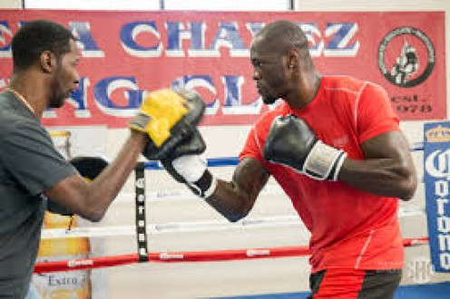 Deontay Wilder and trainer Mark Breland workout using the punch mitts in preparation for an upcoming bout.