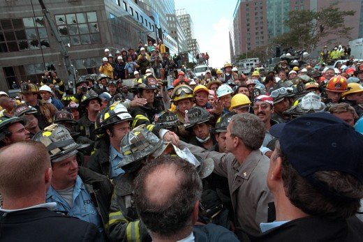 President Bush greets first  responders and crowds who  came to help after te 911 terrorist  attack on The Twin Towers