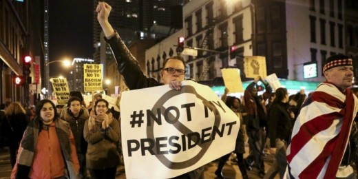"Protester holding sign reading ""Not my President"""