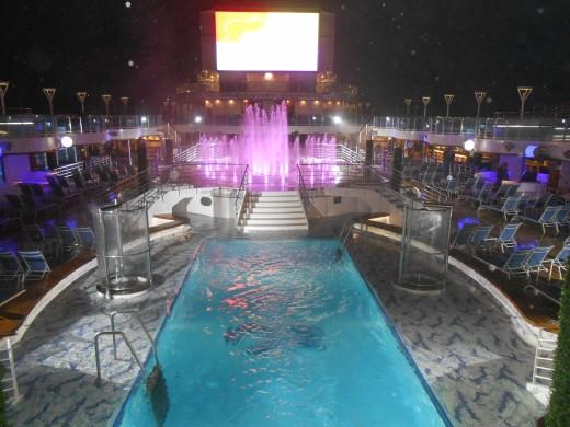 Dancing fountains at night on the Royal Princess cruise ship.