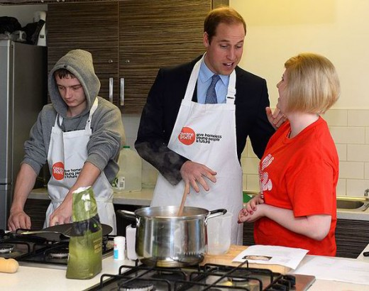 Cooking wearing a tie?  Hey! He's a Prince of the British Empire.  Red blood, blue blood, boys must learn to feed themselves.