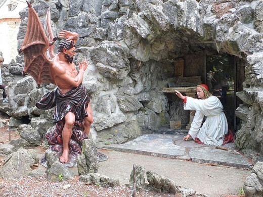 Statue The Temptation of St Anthony in Saint Anthony's Cave (1903) in Crupet, Assesse, Namur, Belgium.